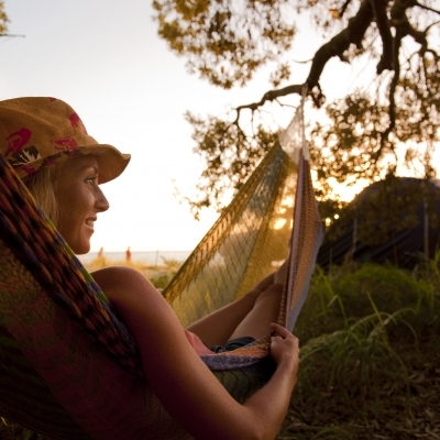 Camping-Young-Woman-in-Hammock