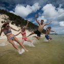 group-jumping-into-water-3