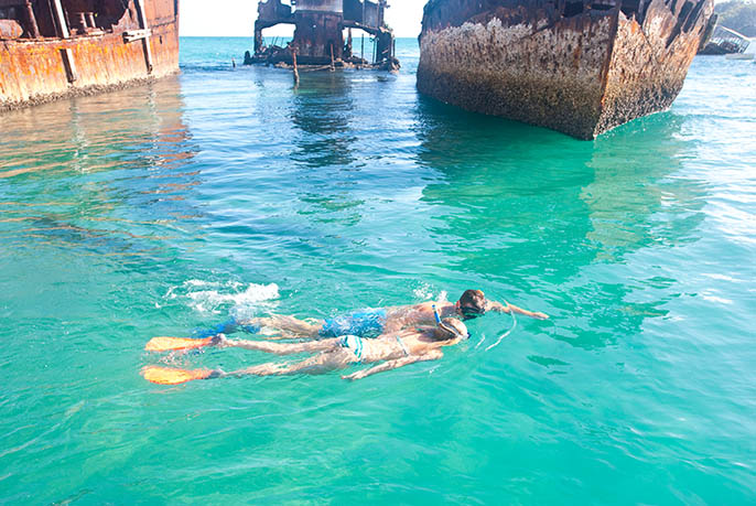 Moreton Island Snorkeling - Young couple Over Wrecks