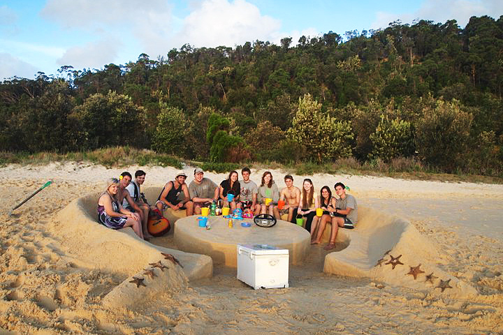 Moreton Island Adventures - Drinks in the sand chair