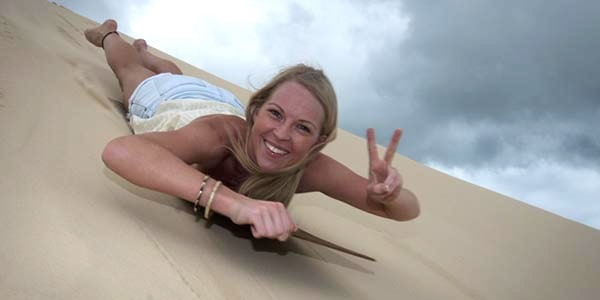 Sandboarding on Moreton Island